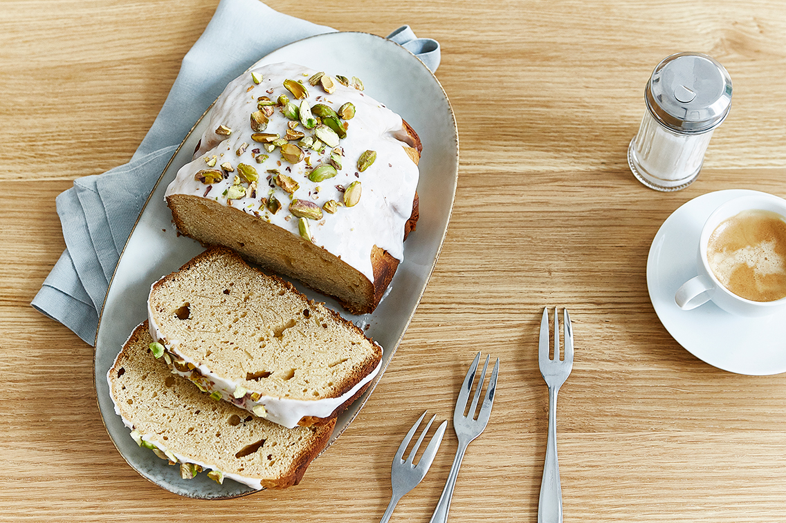 Spice cake with icing and pistachios