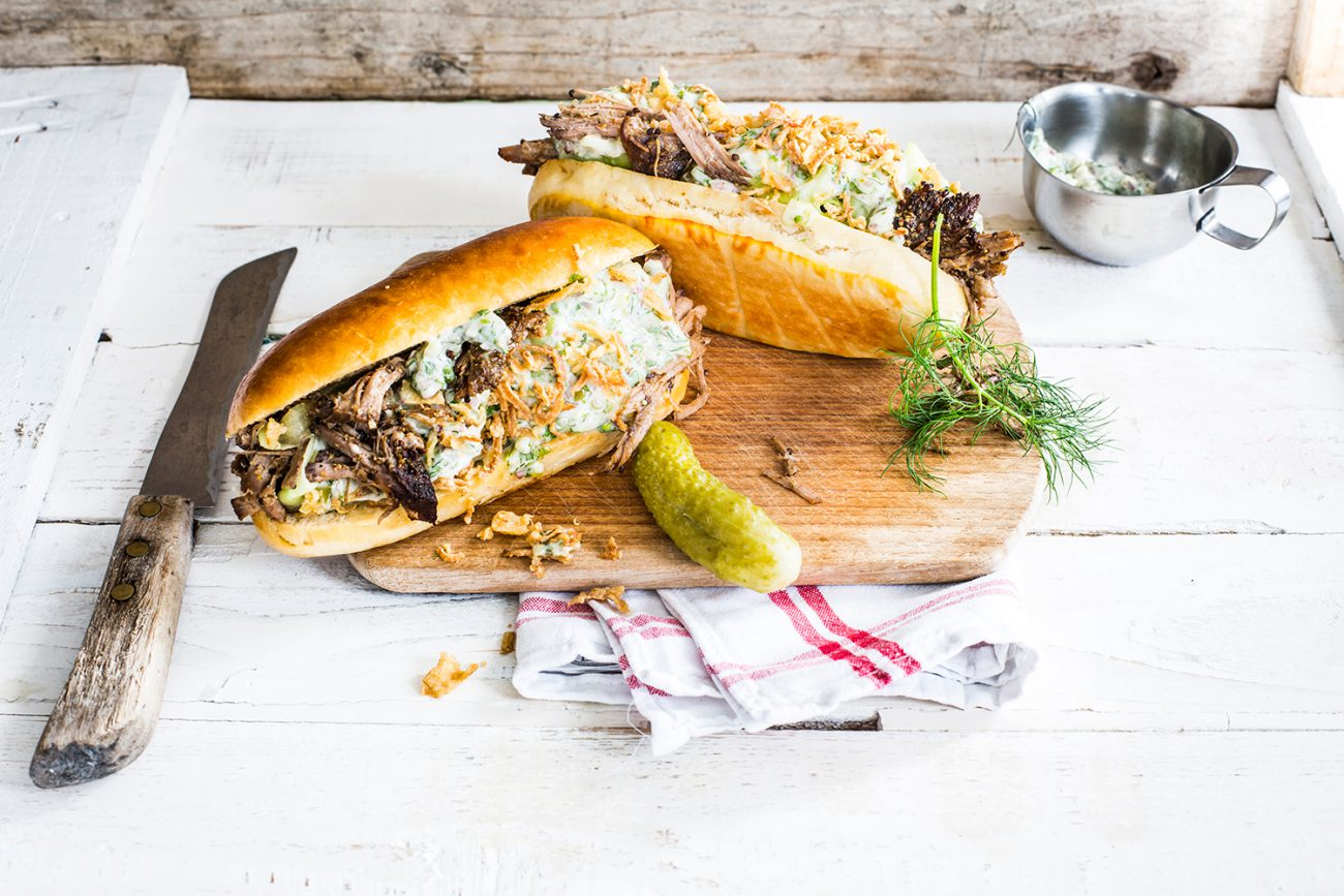 Pulled pork hot dog with mixed herbs
