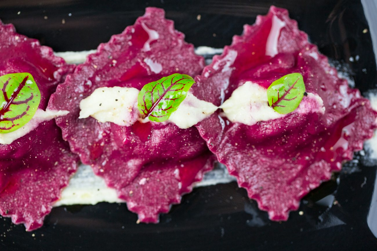 Vegan beetroot ravioli with apple and walnuts
