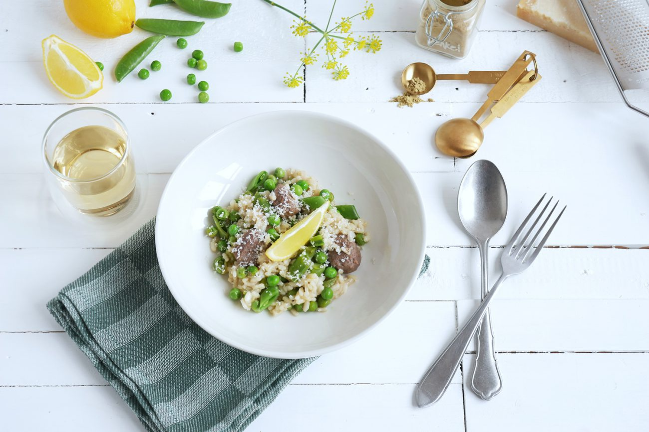 Fresh lemon risotto with sugar snaps, peas and beef sausages